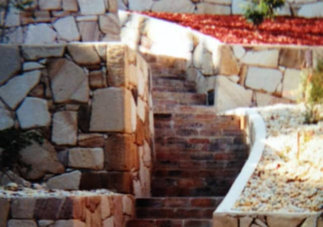landscaped stone wall and steps